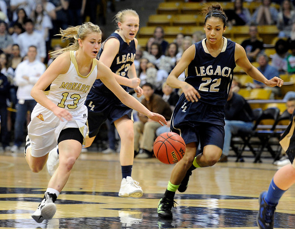 "Monarch High School's Ashton Davis dribbles past Legacy's Kailey Edwards during the Class 5A Colorado State Championship game on Friday, March 9, at the Coors Event Center on the University of Colorado campus in Boulder. Legacy won the game 58-51. For more photos of the game go to  <a href=""http://www.dailycamera.com"">http://www.dailycamera.com</a><br /> Jeremy Papasso/ Camera"