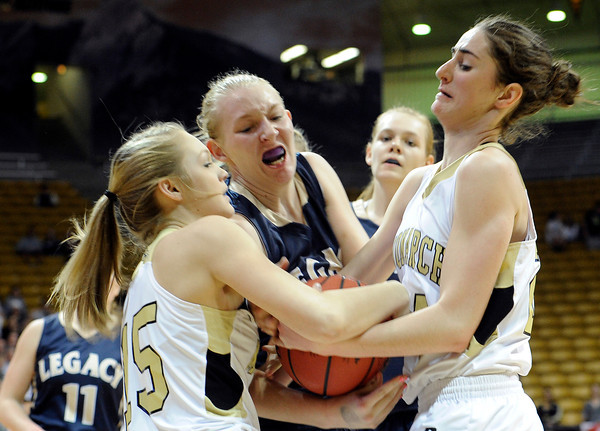"Monarch High School's Reagen Rohn, left, and Jac Malcolm-Peck, right, fight for the ball with Legacy's Caitlyn Smith during the Class 5A Colorado State Championship game on Friday, March 9, at the Coors Event Center on the University of Colorado campus in Boulder. Legacy won the game 58-51. For more photos of the game go to  <a href=""http://www.dailycamera.com"">http://www.dailycamera.com</a><br /> Jeremy Papasso/ Camera"