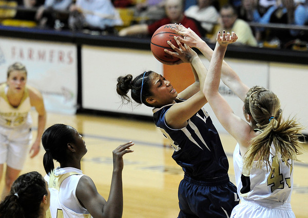 """Legacy High School's Kailey Edwards takes a shot over Monarch's Mae Williams, right, during the Class 5A Colorado State Championship game on Friday, March 9, at the Coors Event Center on the University of Colorado campus in Boulder. Legacy won the game 58-51. For more photos of the game go to  <a href=""""http://www.dailycamera.com"""">http://www.dailycamera.com</a><br /> Jeremy Papasso/ Camera"""