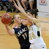 "Legacy High School's Emily Glen takes a shot over Monarch's Jac Malcolm-Peck during the Class 5A Colorado State Championship game against Legacy High School on Friday, March 9, at the Coors Event Center on the University of Colorado campus in Boulder. Legacy won the game 58-51. For more photos of the game go to  <a href=""http://www.dailycamera.com"">http://www.dailycamera.com</a><br /> Jeremy Papasso/ Camera"