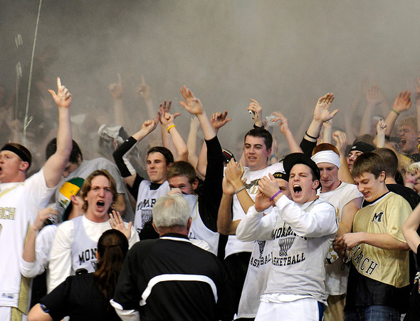 "Monarch High School fans throw chalk into the air at the start Class 5A Colorado State Championship game against Legacy High School on Friday, March 9, at the Coors Event Center on the University of Colorado campus in Boulder. Legacy won the game 58-51. For more photos of the game go to  <a href=""http://www.dailycamera.com"">http://www.dailycamera.com</a><br /> Jeremy Papasso/ Camera"