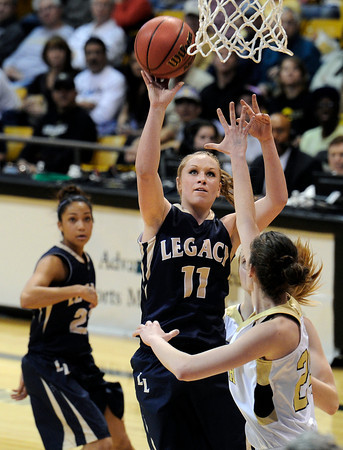 """Legacy High School's Emily Glen takes a shot over Monarch's Jac Malcolm-Peck during the Class 5A Colorado State Championship game on Friday, March 9, at the Coors Event Center on the University of Colorado campus in Boulder. Legacy won the game 58-51. For more photos of the game go to  <a href=""""http://www.dailycamera.com"""">http://www.dailycamera.com</a><br /> Jeremy Papasso/ Camera"""