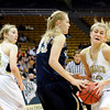 "Monarch High School's Ashton Davis fights for the ball with Legacy's Courtney Smith during the Class 5A Colorado State Championship game on Friday, March 9, at the Coors Event Center on the University of Colorado campus in Boulder. Legacy won the game 58-51. For more photos of the game go to  <a href=""http://www.dailycamera.com"">http://www.dailycamera.com</a><br /> Jeremy Papasso/ Camera"