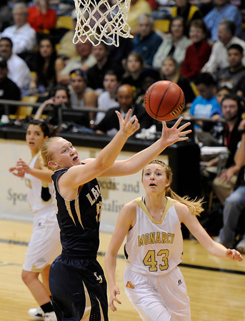 """Legacy High School's Caitlyn Smith snags a rebound over Monarch's Mae Williams during the Class 5A Colorado State Championship game on Friday, March 9, at the Coors Event Center on the University of Colorado campus in Boulder. Legacy won the game 58-51. For more photos of the game go to  <a href=""""http://www.dailycamera.com"""">http://www.dailycamera.com</a><br /> Jeremy Papasso/ Camera"""