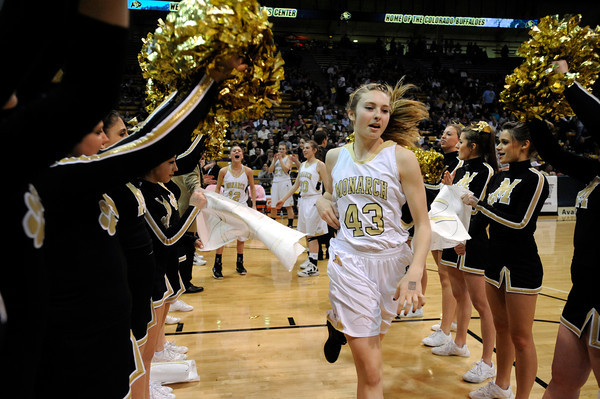"Monarch High School's Mae Williams runs through a gauntlet of cheerleaders at the start of the Class 5A Colorado State Championship game against Legacy High School on Friday, March 9, at the Coors Event Center on the University of Colorado campus in Boulder. Legacy won the game 58-51. For more photos of the game go to  <a href=""http://www.dailycamera.com"">http://www.dailycamera.com</a><br /> Jeremy Papasso/ Camera"