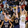 "Monarch High School's Jordan Eisler takes a shot over Legacy's Emily Glen during the Class 5A Colorado State Championship game on Friday, March 9, at the Coors Event Center on the University of Colorado campus in Boulder. Legacy won the game 58-51. For more photos of the game go to  <a href=""http://www.dailycamera.com"">http://www.dailycamera.com</a><br /> Jeremy Papasso/ Camera"