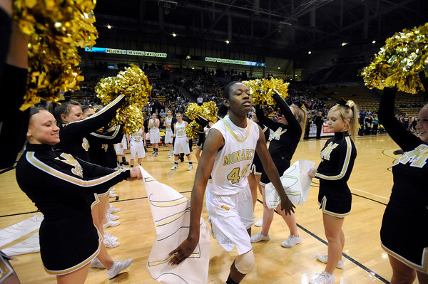 """Monarch High School's Alexus Johnson runs through a gauntlet of cheerleaders at the start of the Class 5A Colorado State Championship game against Legacy High School on Friday, March 9, at the Coors Event Center on the University of Colorado campus in Boulder. Legacy won the game 58-51. For more photos of the game go to  <a href=""""http://www.dailycamera.com"""">http://www.dailycamera.com</a><br /> Jeremy Papasso/ Camera"""