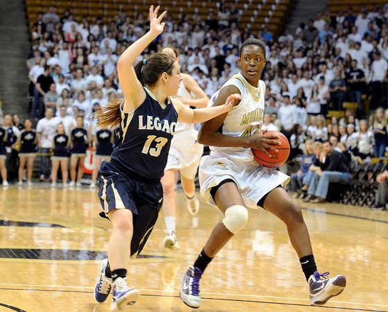 "Monarch High School's Alexus Johnson drives the ball past Legacy's Jordan Salaz during the Class 5A Colorado State Championship game on Friday, March 9, at the Coors Event Center on the University of Colorado campus in Boulder. Legacy won the game 58-51. For more photos of the game go to  <a href=""http://www.dailycamera.com"">http://www.dailycamera.com</a><br /> Jeremy Papasso/ Camera"