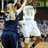 "Monarch High School's Alexus Johnson takes a shot over Legacy's Courtney Smith during the Class 5A Colorado State Championship game on Friday, March 9, at the Coors Event Center on the University of Colorado campus in Boulder. Legacy won the game 58-51. For more photos of the game go to  <a href=""http://www.dailycamera.com"">http://www.dailycamera.com</a><br /> Jeremy Papasso/ Camera"