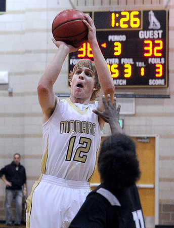 """Monarch High School's Dan Sorenson takes a shot on Friday, Dec. 2, during a game against Montbello High School at Monarch High School in Louisville. For more photos of the game go to  <a href=""""http://www.dailycamera.com"""">http://www.dailycamera.com</a><br /> Jeremy Papasso/ Camera"""