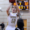 "Monarch High School's Dan Sorenson takes a shot on Friday, Dec. 2, during a game against Montbello High School at Monarch High School in Louisville. For more photos of the game go to  <a href=""http://www.dailycamera.com"">http://www.dailycamera.com</a><br /> Jeremy Papasso/ Camera"