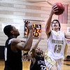 "Monarch High School's Nathan Brooks drives to the hoop past Anthony Carter, No. 32, on Friday, Dec. 2, during a game against Montbello High School at Monarch High School in Louisville. For more photos of the game go to  <a href=""http://www.dailycamera.com"">http://www.dailycamera.com</a><br /> Jeremy Papasso/ Camera"