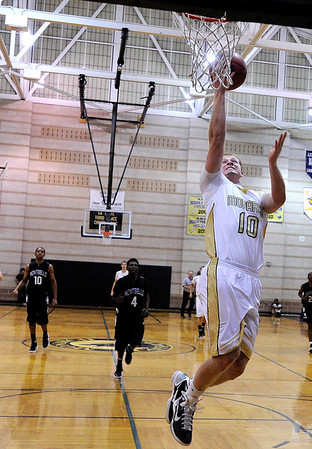 """Monarch High School's Wes Moon goes for a layup after a fast break on Friday, Dec. 2, during a game against Montbello High School at Monarch High School in Louisville. For more photos of the game go to  <a href=""""http://www.dailycamera.com"""">http://www.dailycamera.com</a><br /> Jeremy Papasso/ Camera"""