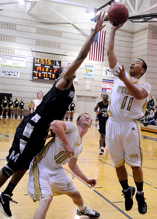 "Monarch High School's Hank Yen shoots a two-pointer over a Montbello defender on Friday, Dec. 2, during a game against Montbello High School at Monarch High School in Louisville. For more photos of the game go to  <a href=""http://www.dailycamera.com"">http://www.dailycamera.com</a><br /> Jeremy Papasso/ Camera"