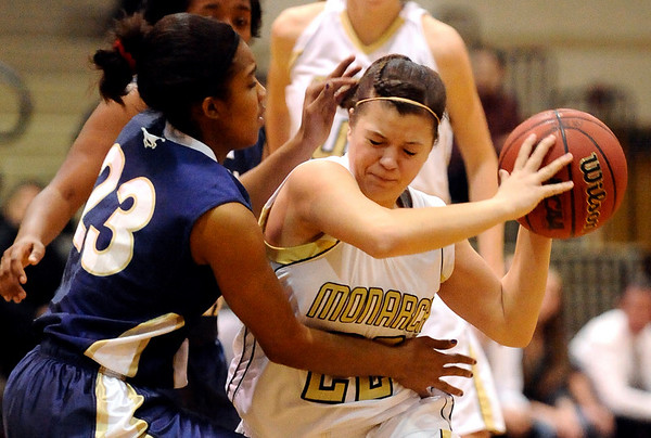 Monarch's Hamma Stimac (right) collides with Mullen's Jaidah Richardson (left) during their basketball game Monarch High School in Louisville, Colorado December 8, 2009.  CAMERA/Mark Leffingwell