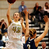 Monarch's Eliza Normen (left) takes a shot over the reach of Mullen's Haley Thompson (right) during their basketball game Monarch High School in Louisville, Colorado December 8, 2009.  CAMERA/Mark Leffingwell