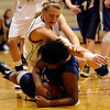 Monarch's Mattie Stanford (top) tackles Mullen's Bailey Holland (bottom) going for the ball during their basketball game Monarch High School in Louisville, Colorado December 8, 2009.  CAMERA/Mark Leffingwell