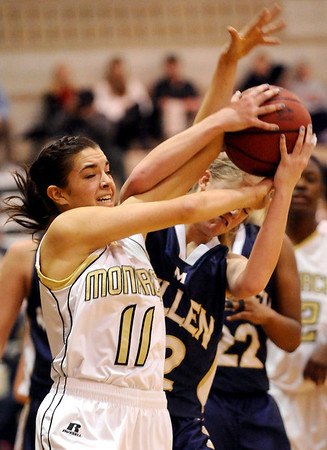 Monarch's Rebecca Richmond (left) fights Mullen's Tori Curneen (right) for a rebound during their basketball game Monarch High School in Louisville, Colorado December 8, 2009.  CAMERA/Mark Leffingwell