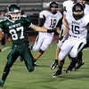 "Niwot High School's Elijah Noterman, left, runs the ball past Braden Pape, No. 15, during a game on Thursday, Sept. 13, against Monarch High School at Longmont High School. Monarch won the game 53-12. For more photos of the game go to  <a href=""http://www.dailycamera.com"">http://www.dailycamera.com</a><br /> Jeremy Papasso/ Camera"