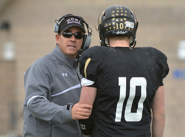 Monarch's head coach Phil Bravo talks with quarterback Cole Watson during the state 4A semi-final game against Pueblo West at Warrior Stadium in Lafayette on Saturday.<br /> <br /> November 24, 2012<br /> staff photo/ David R. Jennings