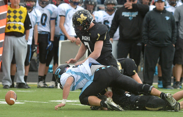 Monarch and  Pueblo West players scramble to catch a loose ball during the state 4A semi-final game at Warrior Stadium in Lafayette on Saturday.<br /> <br /> November 24, 2012<br /> staff photo/ David R. Jennings