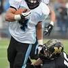 Monarch's Geoff Clary tackles Pueblo West's Derek Jackson during the state 4A semi final game at Warrior Stadium on Saturday.<br /> <br /> November 24, 2012<br /> staff photo/ David R. Jennings