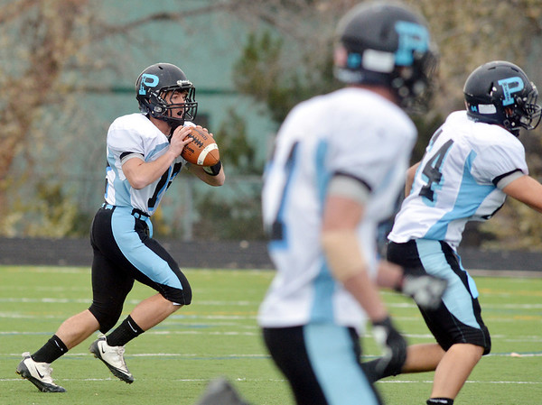 Pueblo West's quarterback Zac Drury prepares to pass against Monarch during the state 4A semi-final game at Warrior Stadium in Lafayette on Saturday.<br /> <br /> November 24, 2012<br /> staff photo/ David R. Jennings