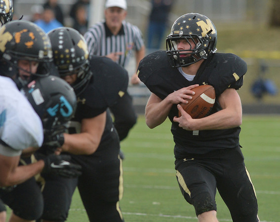 Monarch's Ethan Marks runs the ball against Pueblo West during the state 4A semi final game at Warrior Stadium in Lafayette on Saturday.<br /> <br /> November 24, 2012<br /> staff photo/ David R. Jennings
