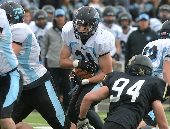 Pueblo West's Austin Bass carries the ball through the line against Monarch during the state 4A semi-final game at Warrior Stadium in Lafayette on Saturday.<br /> <br /> November 24, 2012<br /> staff photo/ David R. Jennings