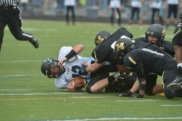 Monarch players sack Pueblo West's quarterback Zac Drury during the state 4A semi-final game at Warrior Stadium on Saturday.<br /> <br /> November 24, 2012<br /> staff photo/ David R. Jennings