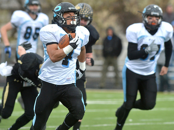 Pueblo West's Derek Jackson runs downfield for a touchdown against Monarch during the state 4A semi-final game at Warrior Stadium in Lafayette on Saturday.<br /> <br /> November 24, 2012<br /> staff photo/ David R. Jennings