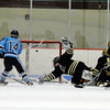 "Broomfield High School's Ian Oden, playing for Monarch High School, misses a save as Ralston Valley's Casey Riccatone scores the winning goal in overtime on Tuesday, Feb. 7, during a game against Ralston Valley High School at the Apex Center in Arvada. Ralston Valley won the game 4-3. For more photos of the game go to  <a href=""http://www.dailycamera.com"">http://www.dailycamera.com</a><br /> Jeremy Papasso/ Camera"