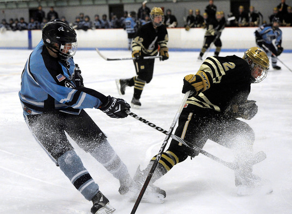"""Fairview High School's Noah Zimmerman, playing for Monarch High School, at right, fights for the puck with Ralston Valley's Jesse Bunce on Tuesday, Feb. 7, during a game against Ralston Valley High School at the Apex Center in Arvada. Ralston Valley won the game 4-3. For more photos of the game go to  <a href=""""http://www.dailycamera.com"""">http://www.dailycamera.com</a><br /> Jeremy Papasso/ Camera"""