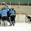 "Broomfield High School's Ian Oden, kneels next to the goal while the Ralston Valley hockey team celebrates after scoring the winning goal in overtime on Tuesday, Feb. 7, during a game against Ralston Valley High School at the Apex Center in Arvada. Ralston Valley won the game 4-3. For more photos of the game go to  <a href=""http://www.dailycamera.com"">http://www.dailycamera.com</a><br /> Jeremy Papasso/ Camera"