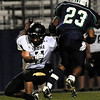 "Monarch High School senior Isaac Marks, left, makes a tackle on Standley Lake running back Sean Jones during a football game on Thursday, Oct. 7, at the North Area Athletic Complex in Arvada.<br /> For more photos go to  <a href=""http://www.dailycamera.com"">http://www.dailycamera.com</a><br /> Photo by Jeremy Papasso"