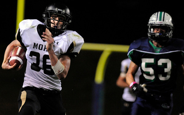 "Monarch High School junior Jared Meschke, left, rushes the ball past Standley Lake senior Patrick Schall during a football game on Thursday, Oct. 7, at the North Area Athletic Complex in Arvada.<br /> For more photos go to  <a href=""http://www.dailycamera.com"">http://www.dailycamera.com</a><br /> Photo by Jeremy Papasso"