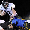 "Monarch High School junior Gus Sawicki tries to break a tackle on Friday, Nov. 5, during a football game against Wheat Ridge High School at Jeffco Stadium in Lakewood.<br /> Monarch defeated Wheat Ridge 26-14.<br /> For more photos go to  <a href=""http://www.dailycamera.com"">http://www.dailycamera.com</a><br /> Jeremy Papasso/ Camera"