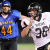 "Monarch High School junior Jared Meschke gains big yardage while being chased by Wheat Ridge senior Andy Field late in the fourth quarter on Friday, Nov. 5, during a football game against Wheat Ridge High School at Jeffco Stadium in Lakewood.<br /> Monarch defeated Wheat Ridge 26-14.<br /> For more photos go to  <a href=""http://www.dailycamera.com"">http://www.dailycamera.com</a><br /> Jeremy Papasso/ Camera"