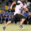 "Monarch High School senior Ryan Muller rushes in for a touchdown on Friday, Nov. 5, during a football game against Wheat Ridge High School at Jeffco Stadium in Lakewood.<br /> Monarch defeated Wheat Ridge 26-14.<br /> For more photos go to  <a href=""http://www.dailycamera.com"">http://www.dailycamera.com</a><br /> Jeremy Papasso/ Camera"