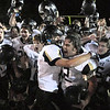 "Monarch High School junior Luke Yontz, left, hugs sophomore Tyler Bender while joining the victory celebration on Friday, Nov. 5, after defeating Wheat Ridge High School in a football game at Jeffco Stadium in Lakewood.<br /> Monarch defeated Wheat Ridge 26-14.<br /> For more photos go to  <a href=""http://www.dailycamera.com"">http://www.dailycamera.com</a><br /> Jeremy Papasso/ Camera"