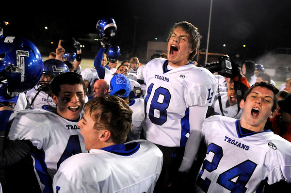 "Longmont High School senior Mikal Merrill, No. 18, shows his emotion with his teammates on Friday, Nov. 12, after defeating Monarch High School in a football game at Centaurus High School in Lafayette.<br /> Longmont defeated Monarch 42-24.<br /> For more photos go to  <a href=""http://www.dailycamera.com"">http://www.dailycamera.com</a><br /> Photo by Jeremy Papasso"