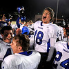 """Longmont High School senior Mikal Merrill, No. 18, shows his emotion with his teammates on Friday, Nov. 12, after defeating Monarch High School in a football game at Centaurus High School in Lafayette.<br /> Longmont defeated Monarch 42-24.<br /> For more photos go to  <a href=""""http://www.dailycamera.com"""">http://www.dailycamera.com</a><br /> Photo by Jeremy Papasso"""