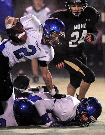 "Longmont High School senior Cameron Herbert rushes the ball on Friday, Nov. 12, during a football game against Monarch High School at Centaurus High School in Lafayette. Longmont defeated Monarch 42-24.<br /> For more photos go to  <a href=""http://www.dailycamera.com"">http://www.dailycamera.com</a><br /> Photo by Jeremy Papasso"