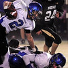 """Longmont High School senior Cameron Herbert rushes the ball on Friday, Nov. 12, during a football game against Monarch High School at Centaurus High School in Lafayette. Longmont defeated Monarch 42-24.<br /> For more photos go to  <a href=""""http://www.dailycamera.com"""">http://www.dailycamera.com</a><br /> Photo by Jeremy Papasso"""