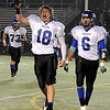 """Longmont High School senior Mikal Merrill, left, and senior Darian Finley-Garcia, right, run off the field with excitement on Friday, Nov. 12, after defeating Monarch High School at Centaurus High School in Lafayette. Longmont defeated Monarch 42-24.<br /> For more photos go to  <a href=""""http://www.dailycamera.com"""">http://www.dailycamera.com</a><br /> Photo by Jeremy Papasso"""