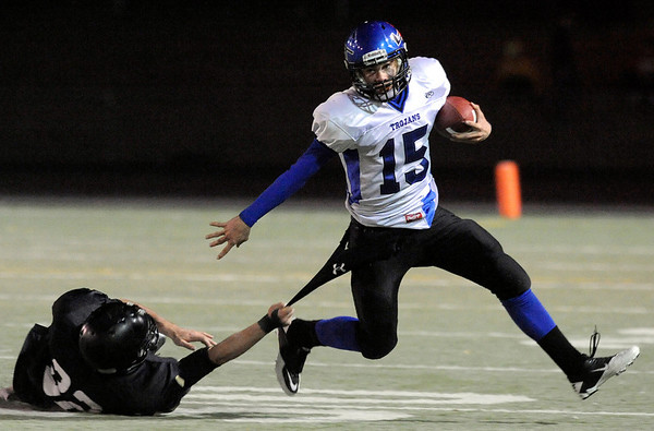 """Longmont High School quarterback Forrest Wetterstrom tries to shake a monarch defender in the second quarter of the football game on Friday, Nov. 12,  against Monarch High School at Centaurus High School in Lafayette.<br /> Longmont defeated Monarch 42-24.<br /> For more photos go to  <a href=""""http://www.dailycamera.com"""">http://www.dailycamera.com</a><br /> Photo by Jeremy Papasso"""