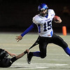 "Longmont High School quarterback Forrest Wetterstrom tries to shake a monarch defender in the second quarter of the football game on Friday, Nov. 12,  against Monarch High School at Centaurus High School in Lafayette.<br /> Longmont defeated Monarch 42-24.<br /> For more photos go to  <a href=""http://www.dailycamera.com"">http://www.dailycamera.com</a><br /> Photo by Jeremy Papasso"