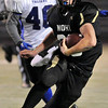 """Monarch High School junior Jared Meschke rushes the ball on Friday, Nov. 12, during a football game against Longmont High School at Centaurus High School in Lafayette. Longmont defeated Monarch 42-24.<br /> For more photos go to  <a href=""""http://www.dailycamera.com"""">http://www.dailycamera.com</a><br /> Photo by Jeremy Papasso"""