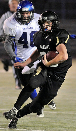 "Monarch High School junior Jared Meschke rushes the ball on Friday, Nov. 12, during a football game against Longmont High School at Centaurus High School in Lafayette. Longmont defeated Monarch 42-24.<br /> For more photos go to  <a href=""http://www.dailycamera.com"">http://www.dailycamera.com</a><br /> Photo by Jeremy Papasso"