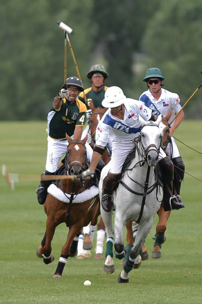 Joel Moline | The Sheridan Press<br /> The Villages Kelly Beal, left, tries to hook BTA's Miguel Astrada during the Moncreiffe Cup Final July 27.